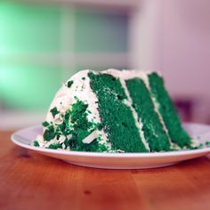 "We all know and love red velvet cake, but let's try a different color out — green for St. Patrick's Day. To make this cake elicit even more ""mmms"" from the crowd, it's iced in a white chocolate cream cheese frosting. We've broken down all the hard parts for you in the video, so you can get to baking and icing a layered cake like a pro."