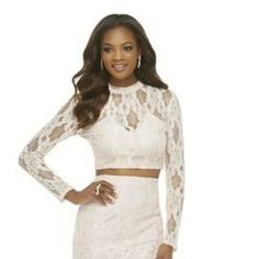 Nude lace crop top Beautiful and elegant lace crop top from the Kardashian Kollection. Color says nude and is a very pretty beige like color. Can be paired up with a midi skirt or high waisted jean for a more casual look. Price is firm, BNWT Kardashian Kollection Tops Crop Tops
