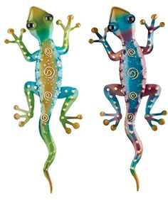 Regal Art & Gift Gecko Decor, Set of 2, Bundle of Rainbow Green and Purple Gecko Wall Art. This bundle of 2 charming geckos will bring fun and whimsy to the walls of your home or garden. Regal Art & Gift's Gecko Decor, Set of 2 bring the vibrant colors of Rainbow Green and Rainbow Purple to your tropical or southwest decor. Hand painted dots and swirls gold accent rich colored metal bodies of these adorable geckos. Treat yourself with this unique set of garden art.