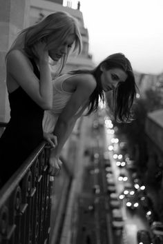 Love this pic. Girls overlooking the city lights.