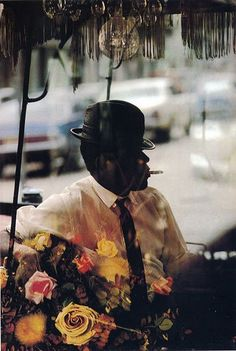 "Saul Leiter, ""Man and Flowers"" 