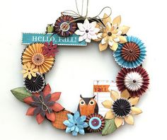 "handcrafted wreath from Little Yellow Bicycle site: Hello, Fall! : Gallery : A Cherry On Top ... paper crafted from scrapbook papers and embellishments ... layered rosettes and flowers in Fall colors ... one cute owl and ""binder paper"" tag ... luv it!"