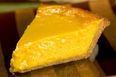 Graham cracker crust 4 mangoes 14 oz (1 can) condensed milk 3 eggs 1/2 cup honey 1/4 tsp ground cardamom 1 Tbsp vanilla extract Bake 350 degrees for one hr- refrigerate few hours