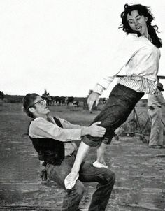 James Dean and Valley Keene (Elizabeth Taylor's double) show off their acrobatic skills on the set of Giant, 1955.