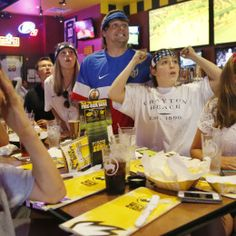 Lauren Wood | Buy at photos.djournal.com Alex Gomez, 14, from left, Hil Fradenburg, Emily Johnson, Taylor Nabors, Kelley Nabors, 17, and Jessie Nabors, 14, react to the game while watching the United States play Belgium in the World Cup on Tuesday at Buffalo Wild Wings.