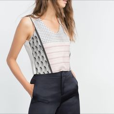 coming soonZara abstract print crop top Cropped top featuring a muted abstract print in the front. V-neck. NWT! Measurements available upon request. Zara Tops Tank Tops