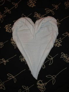 Heart Shaped Folded Towel, Valentine's & Romantic Crafts (photo tutorial here: http://www.firehow.com/2011052527118/how-to-make-a-towel-origami-heart.html)