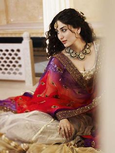 I really do love Kareena Kapoor Silver, grey lengha with a splash of colour with purple and red dupatta