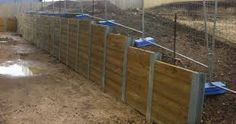 Resultado de imagen de retaining wall wooden sleepers