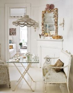 settee + white space + romantic + dining + shell mirror