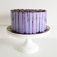 Blueberry sponge #cake with vanilla bean buttercream and a wild berry reduction by Jenna Rae Cakes