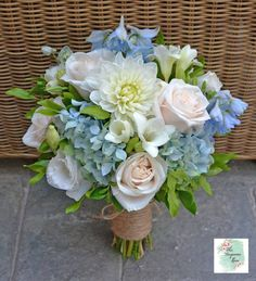 Pretty blue and white 'just picked' bouquet featuring ivory Dahlia, Roses, blue Hydrangea, blue Delphiniums, freesia and pretty soft green foliage.