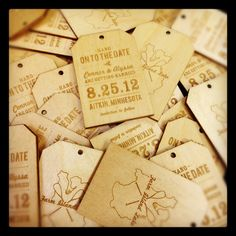Love these. Wooden Save the Date Wedding Announcement Tags - Custom Laser Engraved. $3.50, via Etsy.