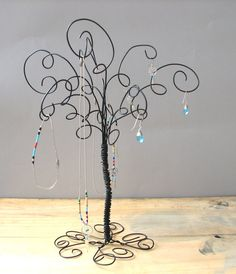 Jewelry Organize Tree jewelry. This would be great for the stuff I constantly wear instead of sticking them in the lid to my hairspray can lol