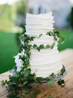Decorate a white cake with greenery. 23 free wedding ideas for brides on a budget #wedding #budget #ideas