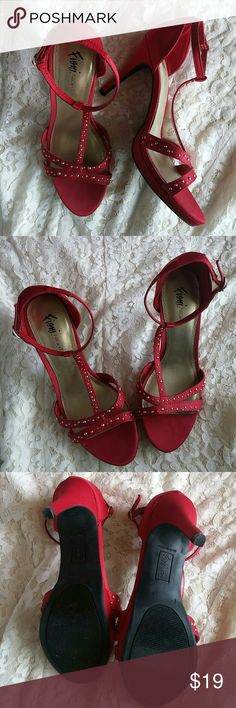 Red and Gold Stud Heels NWOT Beautiful red satinesque fabric with small round gold accents. 4 inch heel. The ankle strap keeps them securely on your feet. Perfect party heel. Never worn. Size 7. Usually I wear a 7.5 but these fit perfectly. Fioni Night Shoes Heels