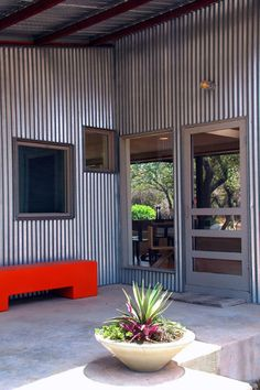 modern exterior by Nick Deaver Architect      I like mixing exterior veneers.  aluminum with barn wood, etc.
