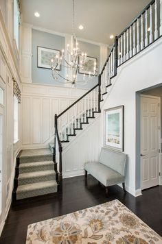 Love the stairs Foyer Paint Color. The paint on the upper wall insets is Sherwin Williams Samovar Silver. The paint on the lower walls is Accessible Beige and the trim is Cottonwhite. Mary Cook Associates Inc. Foyer Paint Colors, Interior Paint Colors, Wall Colors, Paint Colours, Design Entrée, House Design, Design Ideas, Foyer Design, Design Inspiration