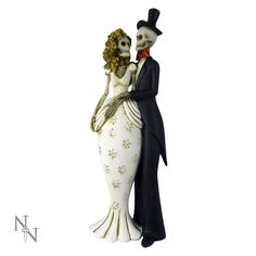 A beautifully detailed bride and groom skeleton set, The bride is wearing a a white dress and sporting a mop of long blonde curly hair. The groom looking dapper in his top hat and tails with red bow tie. Gothic Wedding, Dream Wedding, Long Blonde Curly Hair, Weird Stuff On Amazon, Red Bow Tie, Groom Looks, Looking Dapper, Till Death, 25th Anniversary