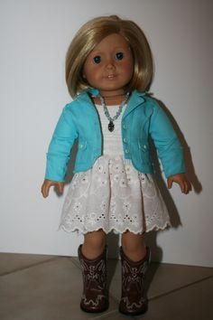 Blue jacket and sundress with cowboy boots