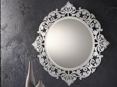 Love the laser cut frame!  Decorative Wall Mirrors by Riflessi
