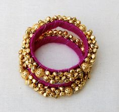A pair of bangles beautifully wrapped with cotton by OneWorldShop Silk Thread Bangles Design, Thread Jewellery, Fabric Jewelry, Fashion Jewellery, Handmade Bracelets, Handcrafted Jewelry, Earrings Handmade, Hyderabadi Jewelry, Bridal Bangles