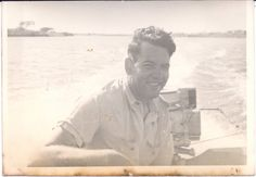 Fun on the water (a vintage photo of a happy man in his boat) by LivingVintageCompany on Etsy