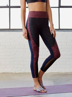 Dylan Legging | Crafted from double-brushed heathered jersey, these leggings feature a so-soft fabric with super sweat-wicking power to keep you dry during your toughest workout. Mesh panels at the leg add a sleek fashion element to this performance style.