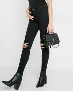 """Step into a denim darling with attitude. Flatteringly tight and comfortably stretchy, this slimming jean legging is built to please. The high rise and ripped knees give it a little extra oomph. Designed to fit and flatter your 5'4"""" and under frame."""
