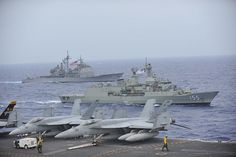HMAS Ballarat is alongside USS Cowpens while in formation with USS George Washington. by Official U.S. Navy Imagery