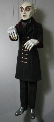 VAMPIRE NOSFERATU MARIONETTE-PUPPET SCULPTURE DOLL (02/08/2011) He is a one of a kind figurative sculpture.This marionette is a wonderful collectible piece,for all vampires lovers,memorabilia and marionette collectors.He is hand build,painted and costumed.Head,hands and shoes are made out of rigid urethane resin, a very hard and durable material.Arms and legs are wood with metal joints.He is 30 inches tall from head to toe.This marionettes are made one by one.Each one is unique.