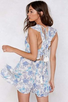 Like a summer with a thousand Julys. The You Grow to My Head Romper  features a floral print throughout eda6db4f9