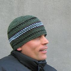 this short (8 long) beanie is hand crocheted with avocado green hemp yarn and accented by stripes of blue, brown and black cotton...it will fit (or stretch to fit) most average size heads (20-23 in circumference)- we are happy to make you a custom size ! 8= 20.32 centimeters long 20-23= 50.80- 58.42 centimeters in circumference  hemp yarn will keep you cool in the summer and warm in the winter- it is one of the most durable fibers available and as it grows softer and softer with each wash…