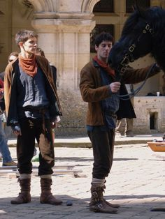 What sorcery is this?? :P It unsettles my stomach a bit to see anyone else in Merlin's costume. Its just so... wrong. Merlin is Merlin. Only Merlin! (btw. the look on Colin's face haha)