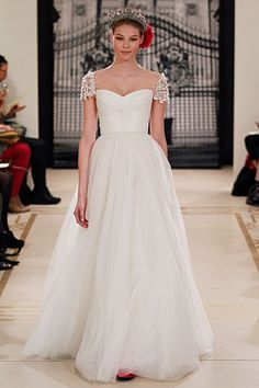 I love those sleeves. I want to take them on a date. Reem Acra Fall 2011 Bridal.