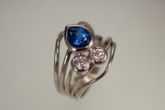 14kw gold ring with diamonds and sapphire