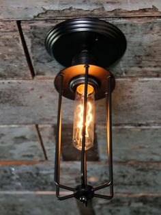 Flush cage light with a linear filament bulb. Cage Light, Flush Lighting, Lighting Online, Wind Chimes, Sconces, Wall Lights, Arms, Bulb, Outdoor Decor