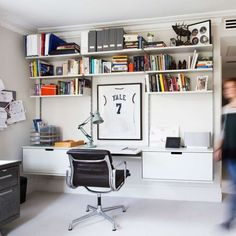 606 Universal Shelving System in a study with a desk shelf and shelving for workspace storage
