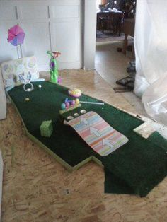 I Made This Easter Putt Putt Hole With Scrap Plywood, Leftover Gifted Turf,  Dollar Store Decorations And A Childrenu0027s Plastic Golf Set.