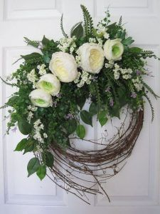 vine wreath with lush greenery and white flowers