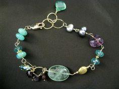Multi Gemstone Green bracelet, Peruvian Amazonite Bracelet, Emerald Bracelet, Apatite and Fluorite Bracelet, Sundance Style Bracelet by DesignByPeiPei on Etsy https://www.etsy.com/listing/185618645/multi-gemstone-green-bracelet-peruvian
