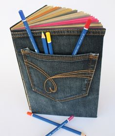 Denim book with a pocket? Doesn't that seem rather awesome? I think I could make at least a book cover for a sketchbook like this.