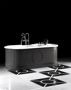 cast iron bathtub without tap holes with exterior covered in aluminium and then painted in one of the 213 colours of the u201ccolors