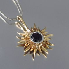 SOLAR ECLIPSE bronze and silver sun pendant with Black Spinel Ready to... ($185) ❤ liked on Polyvore featuring jewelry, pendants, black spinel jewelry, round silver pendant, silver coin jewelry, coin jewellery and bronze jewelry