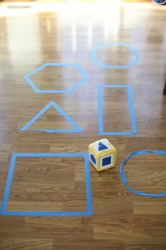 Build shape recognition skills and gross-motor development with a fun indoor or outdoor game. Printable cards for die included.