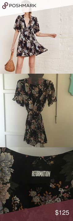 Reformation Guava Dress in Botanic A good excuse to twirl. This is a fit and flare, wrap dress with a deep v neckline, belted waist and drapey sleeve. Perfect condition. Worn only for a few hours. Just needs a good steam. Reformation Dresses