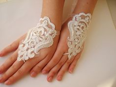 23dollars?? no way. this is a great idea for an easy peasy diy! Ivory Lace Fingerless Gloves. $23.00, via Etsy.
