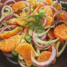 Simple and refreshing salad for a vegan potluck by #vicequeenkitchen: red onion, fennel, clementines dressed with olive oil, Bragg's apple cider vinegar, crushed salt and pepper.