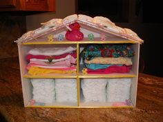 Dollhouse made with foam board (small version). Hot glued together and decorated. Not a toy. Just for packaging baby shower gifts.