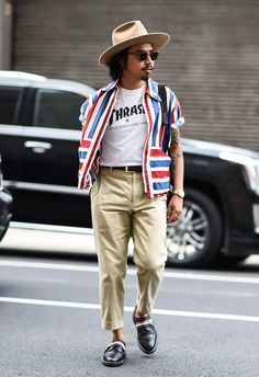 Browse the best street style looks from Men's Fashion Week Spring 2017 | slogan tee, colorful stripes, cropped slacks, fedora